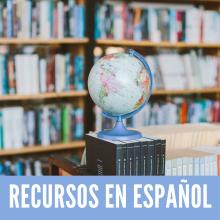 Recursos en Español - A globe in front of a library book shelf