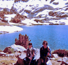 Joel and little brother in 1983 in front of lake with snow in the background.